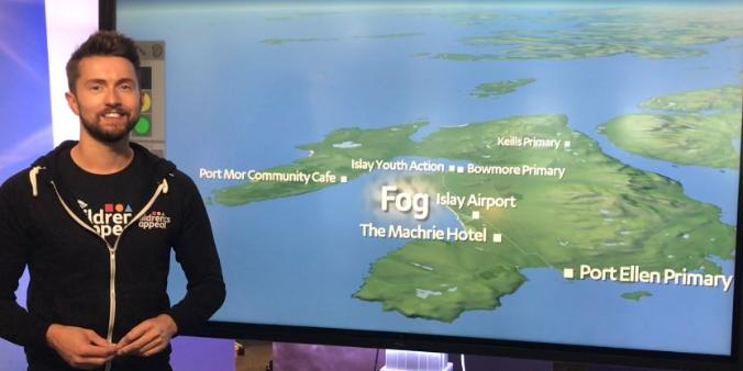Sean Batty in front of weather map of Islay