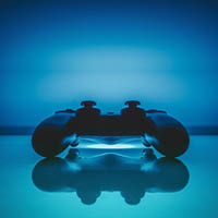 video game controller on blue table