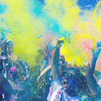 people throwing coloured powder in the air